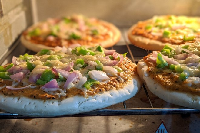 Четыре пиццы